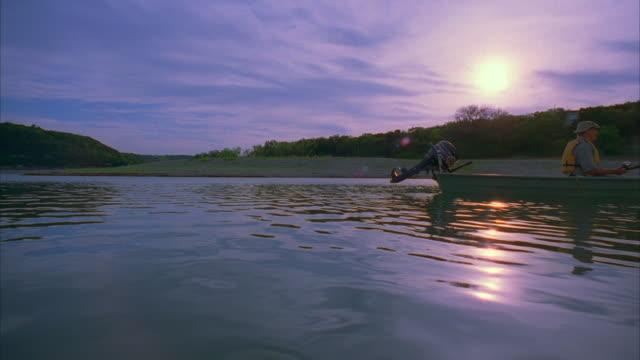 ws pan zi zo slo mo man sitting in boat and fishing / canyon lake, texas, usa - canyon lake stock videos & royalty-free footage