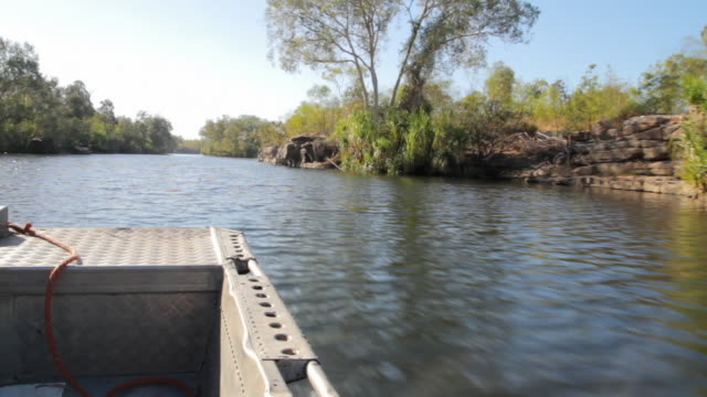 ms pov man sitting in boat and moving away / northern territory, australia - wiese stock videos & royalty-free footage