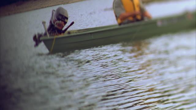 ms tu man sitting in boat, fishing in river / canyon lake, texas, usa - canyon lake stock videos & royalty-free footage