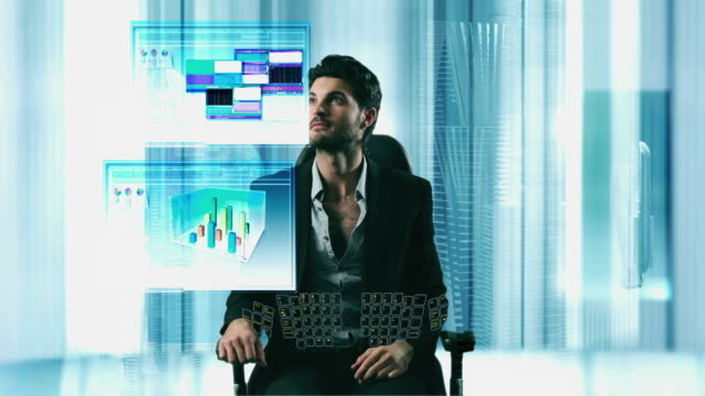 CGI MS Man sitting in front of 3D screens arranging windows of charts and graphs in a futuristic style office