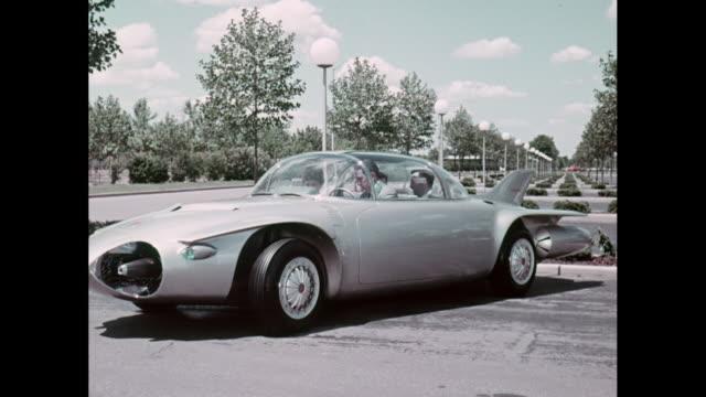 vídeos de stock, filmes e b-roll de ms man sitting in futuristic chevrolet luxury car and driving / united states - vintage car