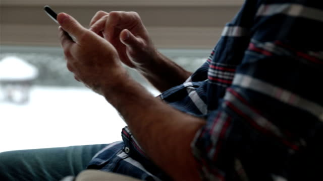 man sitting in rocking chair using smart phone - rocking chair stock videos & royalty-free footage