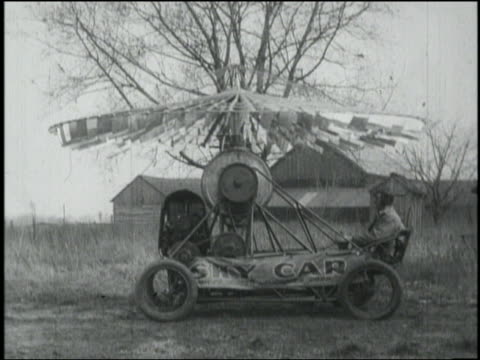 "b/w man sitting in ""sky car"" (early form of helicopter) - air vehicle stock videos & royalty-free footage"