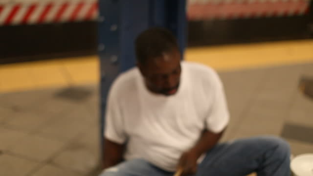 man sitting in the subwaystation playing drums - drummer stock videos & royalty-free footage