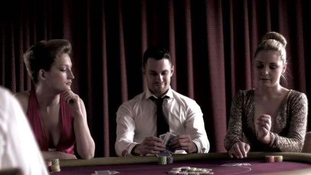 stockvideo's en b-roll-footage met man sitting winning at poker  - overhemd en stropdas