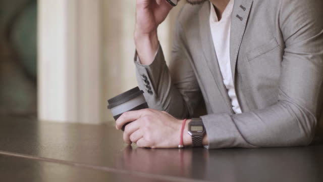 man sitting with a coffee cup - coffee table stock videos & royalty-free footage