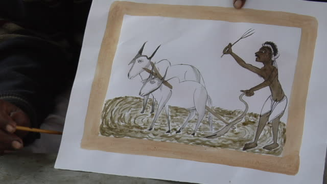 MS ZO Man sitting with holding drawing / Faridabad, Haryana, India