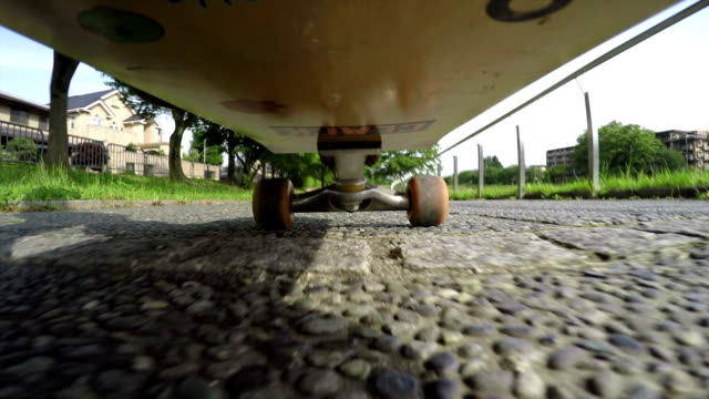man skateboarding on along of the kamo river in kyoto - skateboard stock videos and b-roll footage