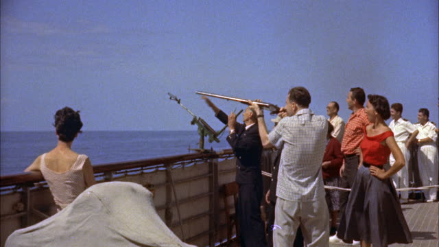 ms man skeet shooting of the side of ship - tiro al piattello video stock e b–roll