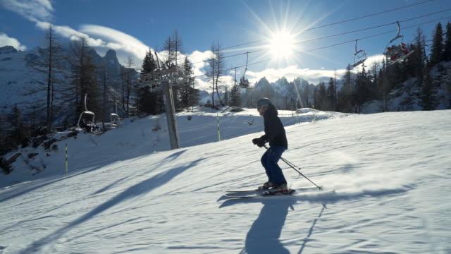 man skiing down mountain - skijacke stock-videos und b-roll-filmmaterial