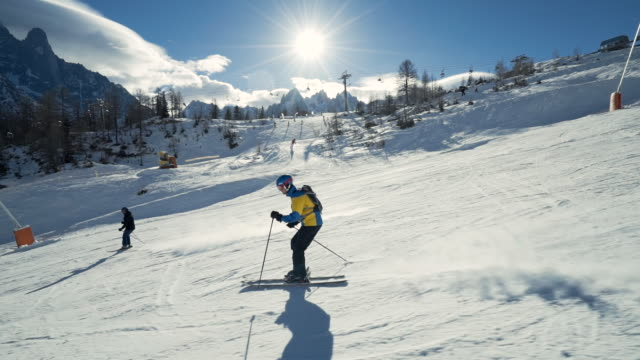 man skiing down mountain - ski jacket stock videos & royalty-free footage