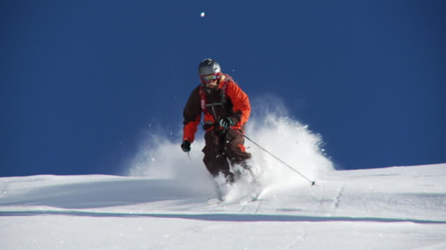MS TS SLO MO Man skiing down on deep powder snow / Alta, Snowbird, Utah, USA