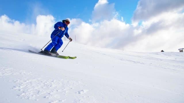 slo mo man skiing down ski slope - alpine skiing stock videos & royalty-free footage