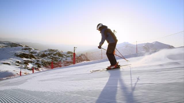SLO MO TS Man skiing in early morning sun