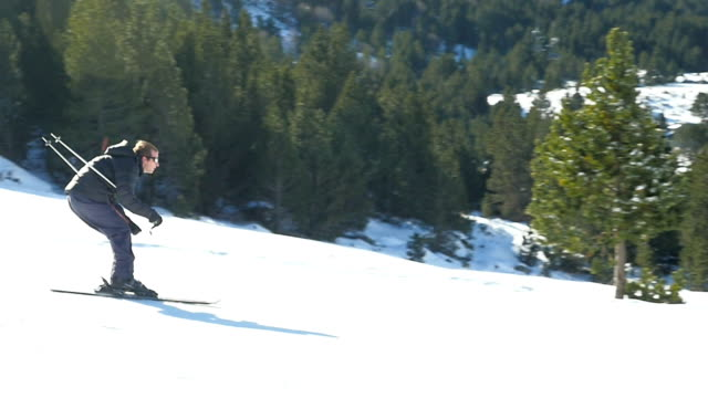 man skiing on a red track.