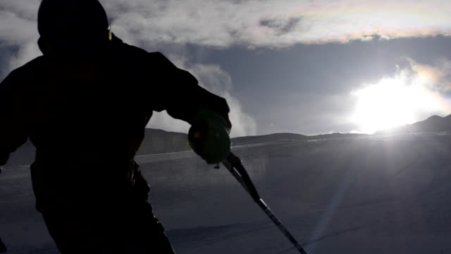 a man skiing on a snow covered mountain. - pulverschnee stock-videos und b-roll-filmmaterial