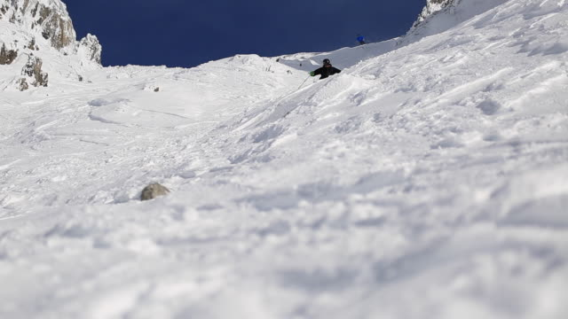A man skiing on a snow covered mountain.