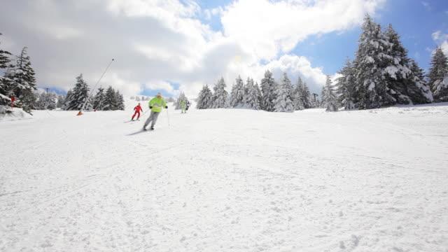 man skiing on the mountains. - fyra människor bildbanksvideor och videomaterial från bakom kulisserna