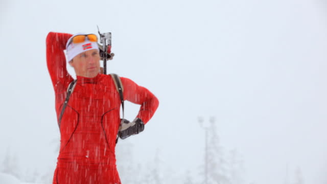 cu pan man skiing then rifle shooting in snowy winter day / whistler ,bc ,canada - biathlon stock videos and b-roll footage