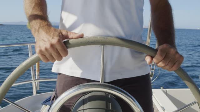 MS A man skippers a sailing boat / Ibiza, Spain