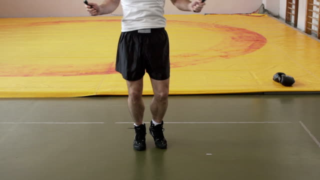 Man skipping rope