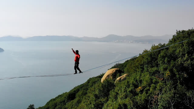 man slacklining in the mountains - rope stock videos & royalty-free footage