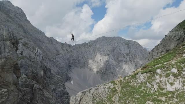 man slacklining on a highline in the alps