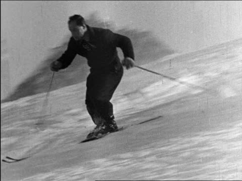 b/w 1940 pan man slalom skiing past camera / industrial - slalom skiing stock videos & royalty-free footage