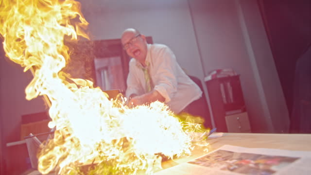 slo mo man slamming the burning laptop with hammer - office stock videos & royalty-free footage
