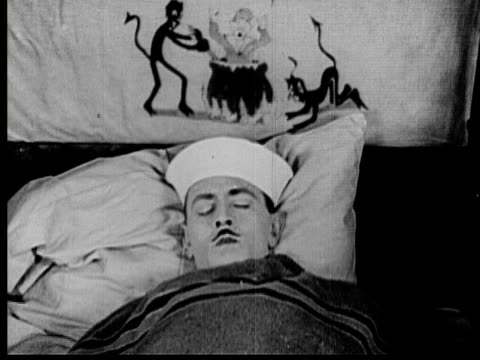 1925 B/W CU Man (Sidney Smith) sleeping and dreaming about being in hell with animated cartoon above his head / Los Angeles County, California, USA