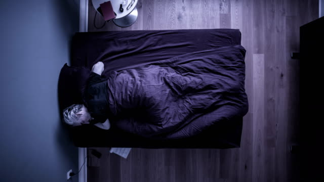 t/l man sleeping in bed - getting out stock videos & royalty-free footage
