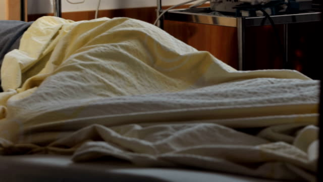 hd dolly: man sleeping in hospital bed - lying on front stock videos & royalty-free footage