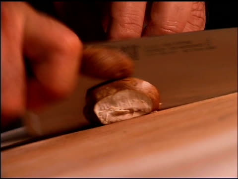 man slicing mushrooms - one mid adult man only stock videos & royalty-free footage