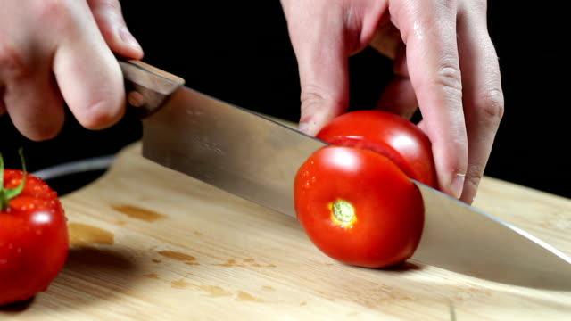 SLO MO Man slicing tomato