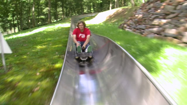 ws pov man sliding at park / saarburg, saar-valley, rhineland-palatinate, germany - rutschen stock-videos und b-roll-filmmaterial