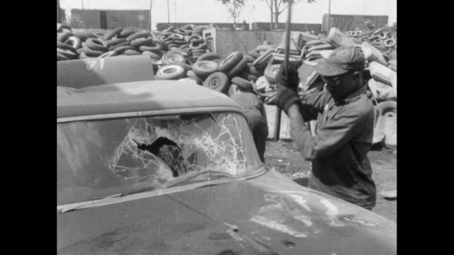 man smashes car windscreens in us scrapyard; 1964 - demolished stock videos & royalty-free footage