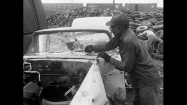 man smashes windscreen on car in scrapyard; 1964 - demolished stock videos & royalty-free footage
