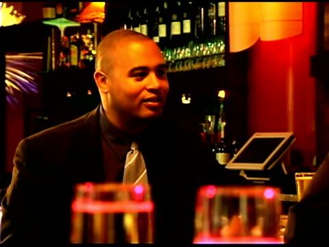 vidéos et rushes de man smiling and nodding in restaurant bar - un seul homme d'âge moyen