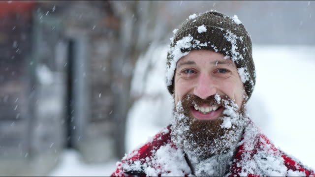 man smiling on a winter's day in vermont - hut stock-videos und b-roll-filmmaterial