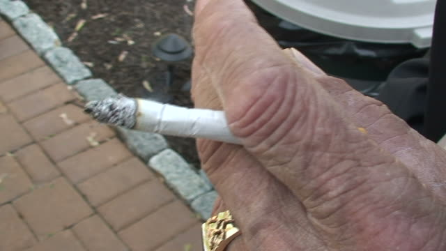 man smoking a cigarette - wastepaper bin stock videos & royalty-free footage