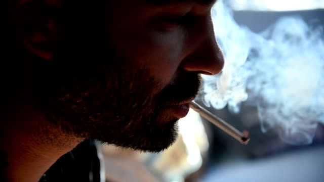 man smoking cigarette. close up. - smoking issues stock videos & royalty-free footage