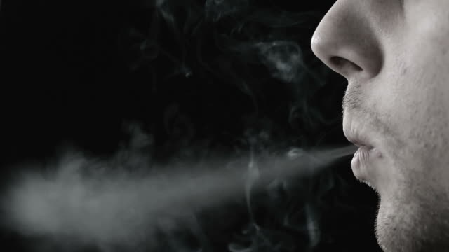 man smoking cigarette in black and white - tobacco product stock videos and b-roll footage