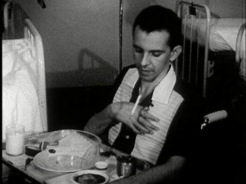 vídeos y material grabado en eventos de stock de ms, b/w, man smoking cigarette sitting in hospital bed, usa - boquilla producto relacionado con el tabaco