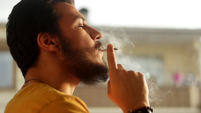 man smoking cigarette - smoking issues stock videos & royalty-free footage