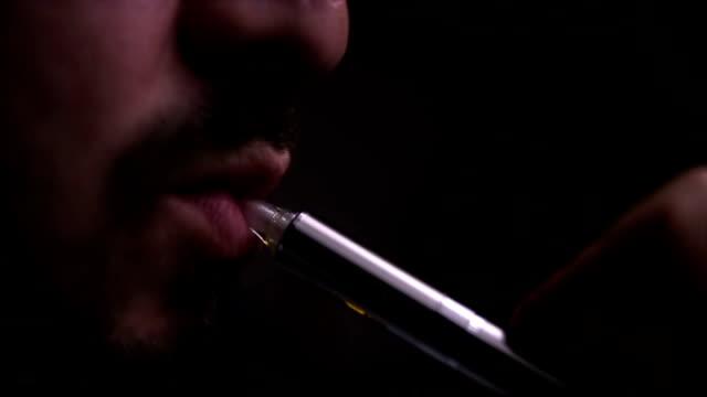 Man smoking e-cigarette,close up