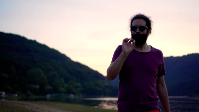 man smoking joint - fumare video stock e b–roll