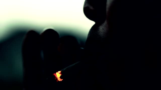man smoking, slow motion - smoking issues stock videos & royalty-free footage
