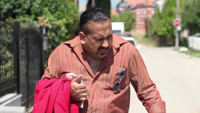 man sneezing on the street - sneezing stock videos & royalty-free footage