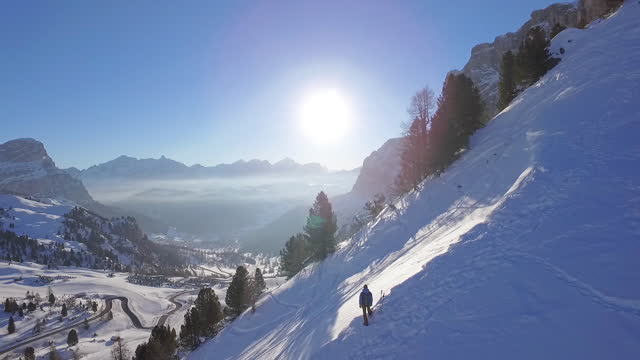 man snowshoeing in the dolomites at sunrise, enjoying view - standing stock-videos und b-roll-filmmaterial