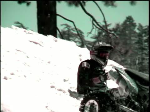 ws, ms, pan, zi, zo, shaky,  man somersaulting on quad bike, crashing into snow on landing, tumbling towards friends, usa - stack stock videos & royalty-free footage